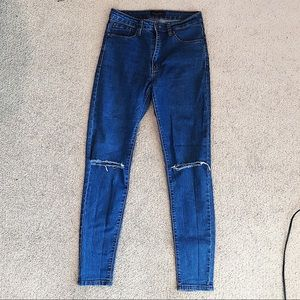 NWOT American Bazi skinny blue jeans with knee rip